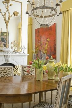 Leopard dining chairs. artwork. chandelier. Gorgeous Dining Room