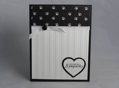 Tell a dog or cat lover that you are sorry for his/her loss by giving this handmade pet sympathy card. It features the sentiment With heartfelt sympathy. This card features a black base that was layered with an embossed, white cardstock, as well as a paw print paper. A ribbon and brad accent the card. ** You can customize the inside by adding some heartfelt words as well as a silhouette of a dog or cat. If you dont specify this in the note to seller section, the inside will be a blank, ...