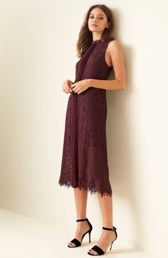 Darkly romantic in vertical pleats and scalloped lace, this midi dress is easy-fitting enough for daytime and sultry enough for date night.
