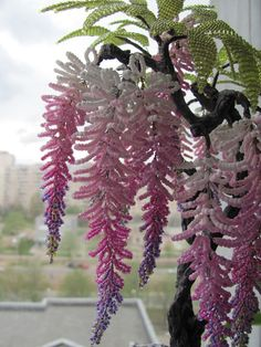 Nan says: These beaded wisteria (?) are incredibly light looking... As if they, like the real flowers, are nearly weightless.