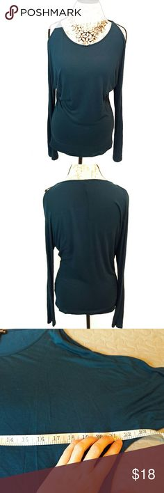 Express cold shoulder shirt In perfect condition. Lovely teal cold shoulder long sleeve shirt by Express. Very soft rayon material. Bust and length Measurements provided in pics above. From a smoke and pet free home. Fast shipping! Office - Vacation - Wedding - Fun - Dress up - date night - cruise - fall - winter *IF YOU LIKE MY ITEMS, please FOLLOW ME to see NEW ARRIVALS that are added weekly! * Express Tops