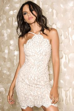 You'll be the hit of any party in the Delicate Darling Beige and Ivory Lace Bodycon Dress! A bodycon fit takes shape below an eyelash lace halter bodice (with darting) that overlays a beige lining. Skirt has a scalloped hem. Adjustable straps. Hidden back zipper/hook clasp.