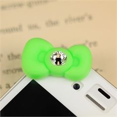 Hello there you cute cell phone charm! This bow adorns the top of your iPhone 4/4S. Simple yet classy with a crystal charm placed in the middle, this dust plug/ ear jack cap accessorizes while keeping the ear jack of your device clean and dust-free.