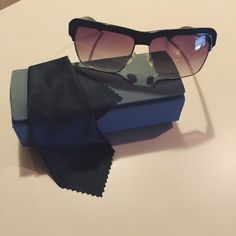 Miu Miu sunnies Black Miu Miu sunglasses.  Purchased in China in 2010 and only worn once.  These are in great condition and made in China-not Italy.  I think these are so unique and sharp. Cloth and sunglass case included.  Let me know if you have questions.  Reasonable offers accepted. Miu Miu Accessories Sunglasses
