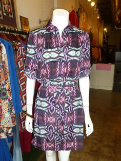 Print shirt dress with sash belt. Sleeves can be rolled up or down.