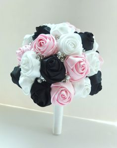 This lovely satin rose brooch bouquet is is perfect for a memorable wedding ! The sphere is approximately 8-9 in diameter and composed of satin