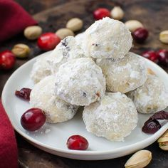 Cranberry pistachio tea cookies are delicate butter cookies dotted with nuts and dried fruit and dusted with confectioners sugar. Wonderful.