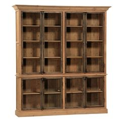 Reclaimed wood body with steel framed glass doors 3 removable shelves in each top cabinet, 1 in each base Requires attachment to wall Built in two pieces.