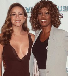 Whitney Houston and Mariah Carey at the 1998 MTV Awards. Photo by Getty Images.
