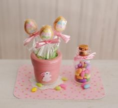 Miniature Easter Egg Cookies On A Stick In A Pink Ceramic Pot With A Bunny On…