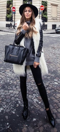 This stylish look is perfect for every day winter wear. In a light jacket worn with a fur vest and black jeans, Kenza Zouiten has achieved a fantastic mix of edginess and sophistication. Jacket: Boda Skins, Faux Fur: Zara, Trousers: Ginatricot, Sweater: Twist & Tango, Bag: Céline, Shoes: Jennie-Ellen.