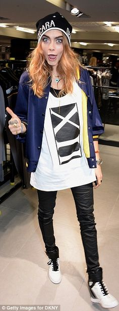 Copycat:Channelling Cara's laidback style, the 40-year-old model caught the eye in a personalized white bomber jacket and a cropped pair of black jeans