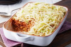 This cabbage casserole is like cabbage rolls undone!  Saucy beef, tender rice, shredded cabbage and onions - no rolling required is required for this oven-baked casserole.