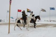 Image copyright                  Reuters                  Image caption                                      Horseback riders patrol the avenue of the flags in the Oceti Sakowin Camp.                                Winter is descending upon thousands of Native Americans camped out in North Dakota as part of the Dakota Access pipeline protests.   Temperatures fre