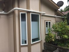 This City of Gig Harbor WA residence has #rainwaterharvesting with 2 X 865 gallon tanks and pump system. Ready for fall and winter rains. Overflow is to the forest area in rear. The arbor carries water from roof to tanks.