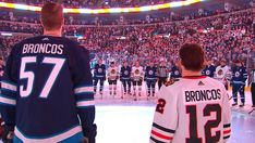 "The Jets and Blackhawks gather at center ice for a moment of silence to honor the victims of the Humboldt tragedy while wearing uniforms with ""Broncos"" etche. Jets Hockey, Ice Hockey, Hockey Room, Hockey Boards, Moment Of Silence, Chicago Blackhawks, Broncos, Nhl, Celebrities"