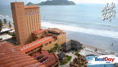 Costa de Oro Beach Hotel de 230 habitaciones es tradición frente a la playa en Mazatlán, en la Zona Dorada, cerca de bares, restaurantes y comercios. Este hotel familiar es una excelente opción para unas vacaciones de playa, para la diversión y el entretenimiento. Además ofrece servicios de spa, club para niños y una amplia gama de actividades acuáticas. Además de que cuenta con instalaciones para bodas y disfrutar una estancia de romance. #OjalaEstuvierasAqui