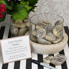 Your wedding guests can place their signing stones into this beautiful glass vase and decorative faux stone base. Each vase measures 8 1/4 inches by 6 inches.