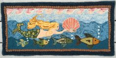 Mermaid rug: Mermaid and Friends design by White Cat Wool, modified and hooked with dyed wool for water/sky by Jane Anderson (Jane@jajets)