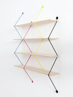 Polish designer Bashko Trybek created 'serpent', a modular shelving system that uses four vivid zigzagging wires as support its wooden planks. since each piece stands alone, the structure becomes adjustable, allowing users to decide on the le Modular Shelving, Storage Shelves, Wall Shelves, Shelving Units, Modern Shelving, Wood Shelf, Kids Storage, Wire Shelving, Corner Shelves