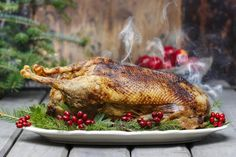 Roast Goose is more flavorful than turkey. Because of this, goose was traditionally served other strong accompaniments such as chestnuts, cabbages, sage, and rosemary. Holiday Dinner, Holiday Foods, Christmas Recipes, Holiday Recipes, Christmas Foods, Christmas Appetizers, Homemade Christmas, Christmas Crafts, Old Farmers Almanac