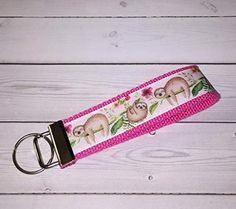 Keep them right on your wrist with our fashionable Key Fobs! Lanyard Keychain, Purse Handles, Sloths, Key Fobs, Key Chains, Shoulder Handbags, Purse Wallet, Lanyards, Computer Mouse