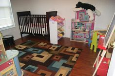 I love the way this Mohawk Home rug really makes the room pop. And while is does not actually match all the lighter, brighter colors in her room, it still looks very nice.