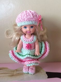 Used size 10 cotton crochet thread. Here's a cute outfit for your cute dolls. Comes with :Hat- has a nice ridge and bow. Dress- in light pink and mint green. Double skirt with embroidery along the edge.
