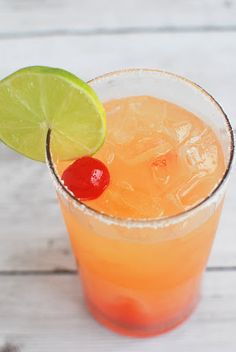 Tequila Sunrise Margarita With Orange Liqueur, Tequila, Lime Juice, Superfine Sugar, Orange Juice, Ice Cubes, Grenadine Syrup