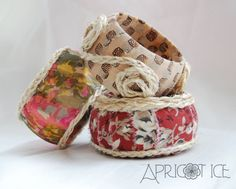 "Wood Bangles Bohemian Gypsy Hippy Fabric Wrapped and Braided Twine ""Garden Folk"" theme complete set. $48.00, via Etsy."