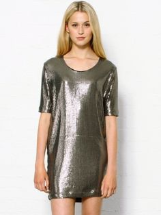 Markus Lupfer Sequin Caren Dress. Stunning sequin dress by Markus Lupfer. The grey metallic dress falls above the knee and has a simple cut with a round neckline and short sleeves. The shimmering Markus Lupfer dress has a relaxed fit and is definitely to be worn as a statement piece. 85% polyester, 10% viscose, 5% elastane. Cold gentle wash only. Model wears XS. Fit is true to size.