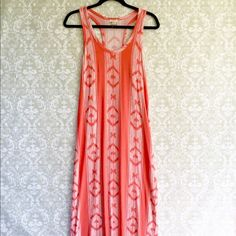 J. Crew coral ikat maxi dress J. Crew coral colored ikat maxi dress. Slit on left side as in 3rd picture. 95% viscose, 5% elastane. Size small. J. Crew Dresses Maxi