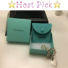 "⭐️2X HOST PICK⭐️  Tiffany Heart Tag Bracelet Authentic Tiffany Heart Tag Bracelet. This is now a retired style. No longer sold. Medium sized to fit up to a 7""-7.5"" wrist size. Hardly worn and in great condition.   Comes with pouch and box.  🚫PRICING FIRM🚫 (really want to keep this but need the money so no offers) 🚫NO OFFERS🚫 🚫NO TRADES🚫 Tiffany & Co. Jewelry Bracelets"