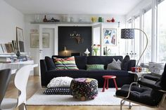 Incredible Lounge Room Transformed From The Unused Carport: remarkable black and white themed for lounge room space featuring cool black fabric sofa also fancy metal arch lamp design and fascinating floral ottoman coffee table – Cooqy.com