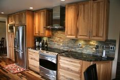 Hickory Kitchen Cabinets Modern Kitchen Design Ideas, Pictures, Remodel and Deco. Hickory Kitchen Cabinets, Kitchen Cabinets And Countertops, Dark Counters, Cupboards, Maple Cabinets, Oak Cabinets, Rustic Kitchen, New Kitchen, Kitchen Tile