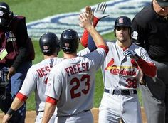 Game 3 of the NLDS- Pete Kozma gets some love from his teammates after batting them in with a 3 run homerun  10-10-12