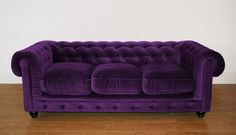 Sumptuous deep purple velvet chesterfield sofa.