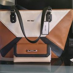 """⬇Nine West Large Tote & Wallet Nine West Color Blocked  large tote is made from faux leather and has a 9"""" handle drop. The main zipper compartment features 1 zipper pocket and 2 media pockets. Dimensions: 10.5""""H x 14""""W x 6.5""""D. Nine West Bags Totes"""