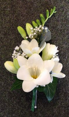 Matt's and Mother of's buttonholes White Freesia and Gypsophila Mothers Corsage Wedding Flowers.jpg (600×1018)