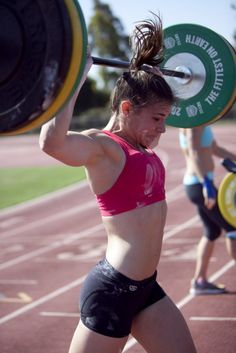 Julie Foucher,  Crossfit Games.    at 195lbs myself, if I extrapolated based on her lift here, I'd have to overhead probably 300lbs. simply amazing. girl power ^4
