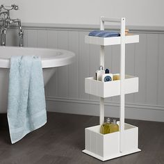 Pristine white with clean, simple lines, this space-saving caddy will keep your bathroom trinkets, toiletries and towels neatly stored and in one convenient place.