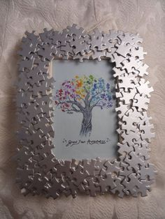 Autism Awareness handmade photo frame with by AutismeAwarenessShop-- easy DIY! Puzzle pieces frame from the dollar tree glue and some spray paint all done :) maybe some sparkles! Puzzle Piece Crafts, Puzzle Art, Frame Crafts, Diy Frame, Puzzle Pieces, Puzzle Frame, Crafts To Make, Crafts For Kids, Arts And Crafts
