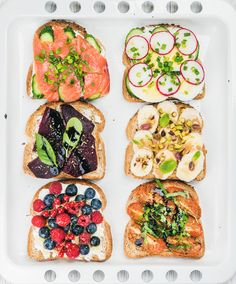 Sweet+and+savory+breakfast+toasts+assortment.+Sandwiches+with+fruit,+vegetables,+eggs,+smoked...+-+Sweet+and+savory+breakfast+toasts+assortment.+Sandwiches+with+fruit,+vegetables,+eggs+and+smoked+salmon+on+white+baking+tray+background,+top+view