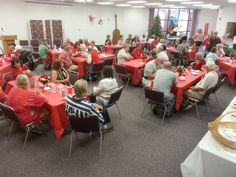 The Craft Vendors are having a good time at their Holiday Banquet in the Library meeting room.