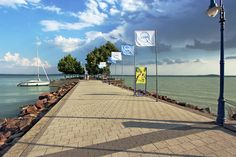 Pier stretches out into the eye-popping multi-colored waters of Revfulop Lake Balaton Hungary