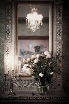 Mirror + chandelier + candles