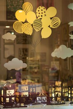 Interesting papercut window display prop.  I also like the cardstock balloon arrangement which could be adapted for a variety of display scenarios.