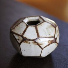 Faceted brown and white vase by LA based artist MrJongo on Etsy