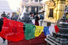 Prayer wheels and monkeys at Swayambhunath in Kathmandu, Nepal -- READ MORE: http://www.asherworldturns.com/prayer-wheels-monkeys-at-swayambhunath/