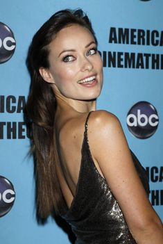 Olivia Wilde Half Up Half Down - Stunning actress Oliva Wilde showed off her sleek half-up half-down hairdo' while walking the red carpet. It was a great hairstyle to showcase her plunging back-line.
